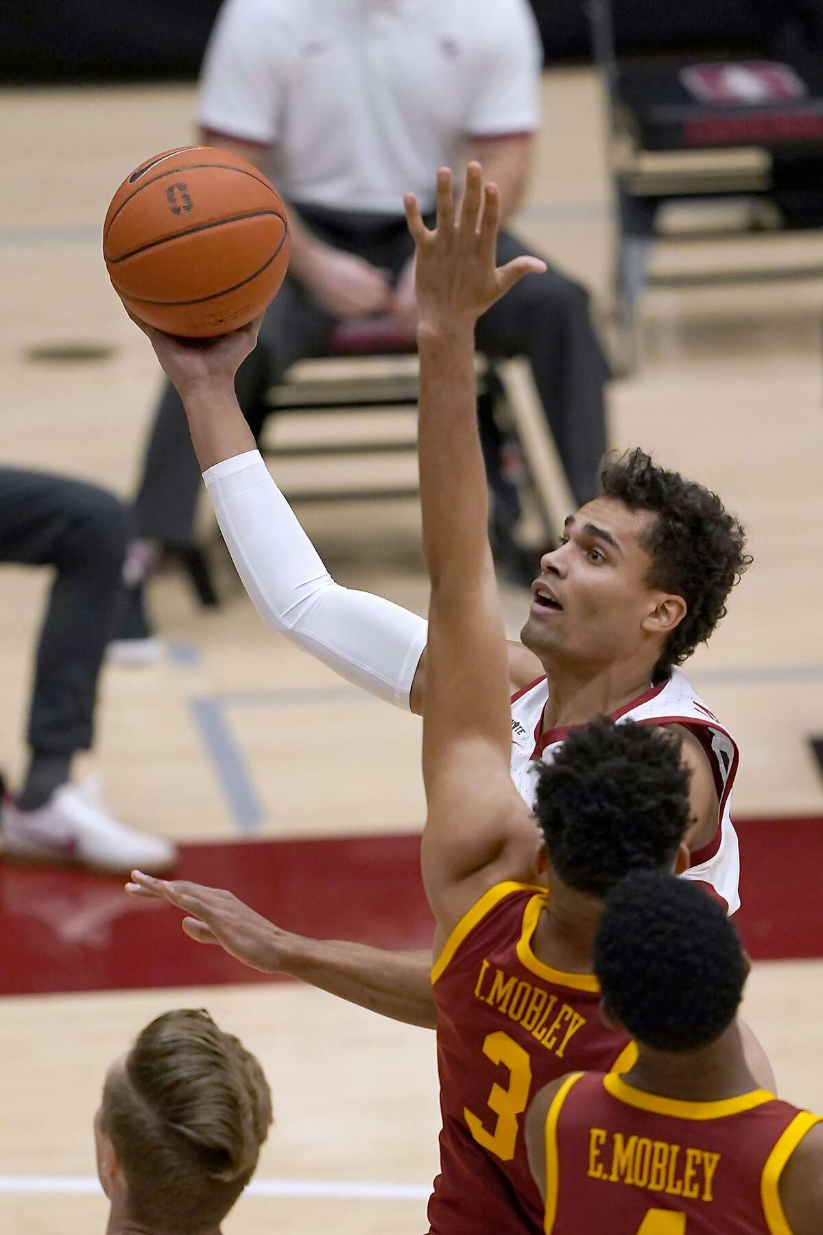 Stanford forward Oscar da Silva drives to the basket against Southern California forward Isaiah Mobley (3) during the first half of an NCAA college basketball game in Stanford, Calif., Tuesday, Feb. 2, 2021. (AP Photo/Tony Avelar)