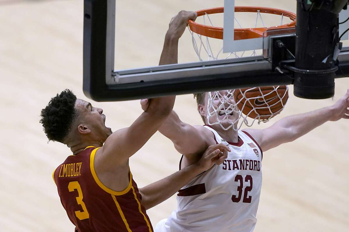 USC's Isaiah Mobley dunks on Stanford forward Lukas Kisunas in the Trojans' victory. It marked the first game the Cardinal played at Maples Pavilion this season.