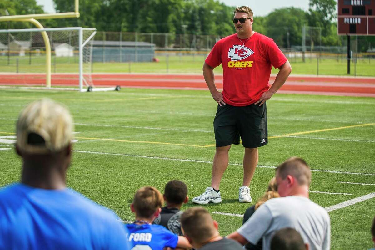 Kansas City Chiefs' Andrew Wylie addresses a group of fifth- and sixth-graders during a Midland High youth football camp on July 9, 2019.
