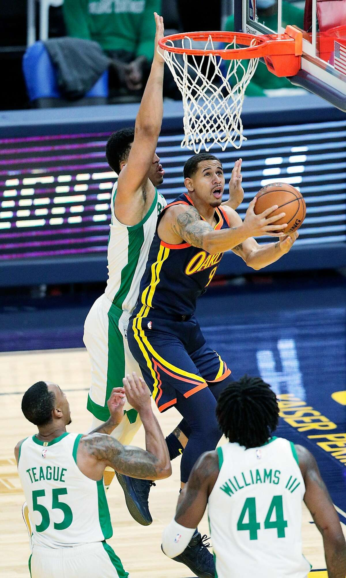 Juan Toscano Anderson (95) shoots in the first half as the Golden State Warriors played the Boston Celtics at Chase Center in San Francisco, Calif., on Tuesday, February 2, 2021.