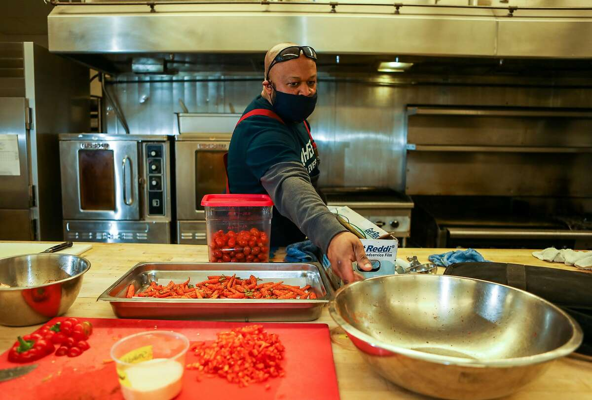 Lamont Perriman, chef/owner of Montperi Catering, preps food as he works in a kitchen at the Port Workspaces in Oakland.