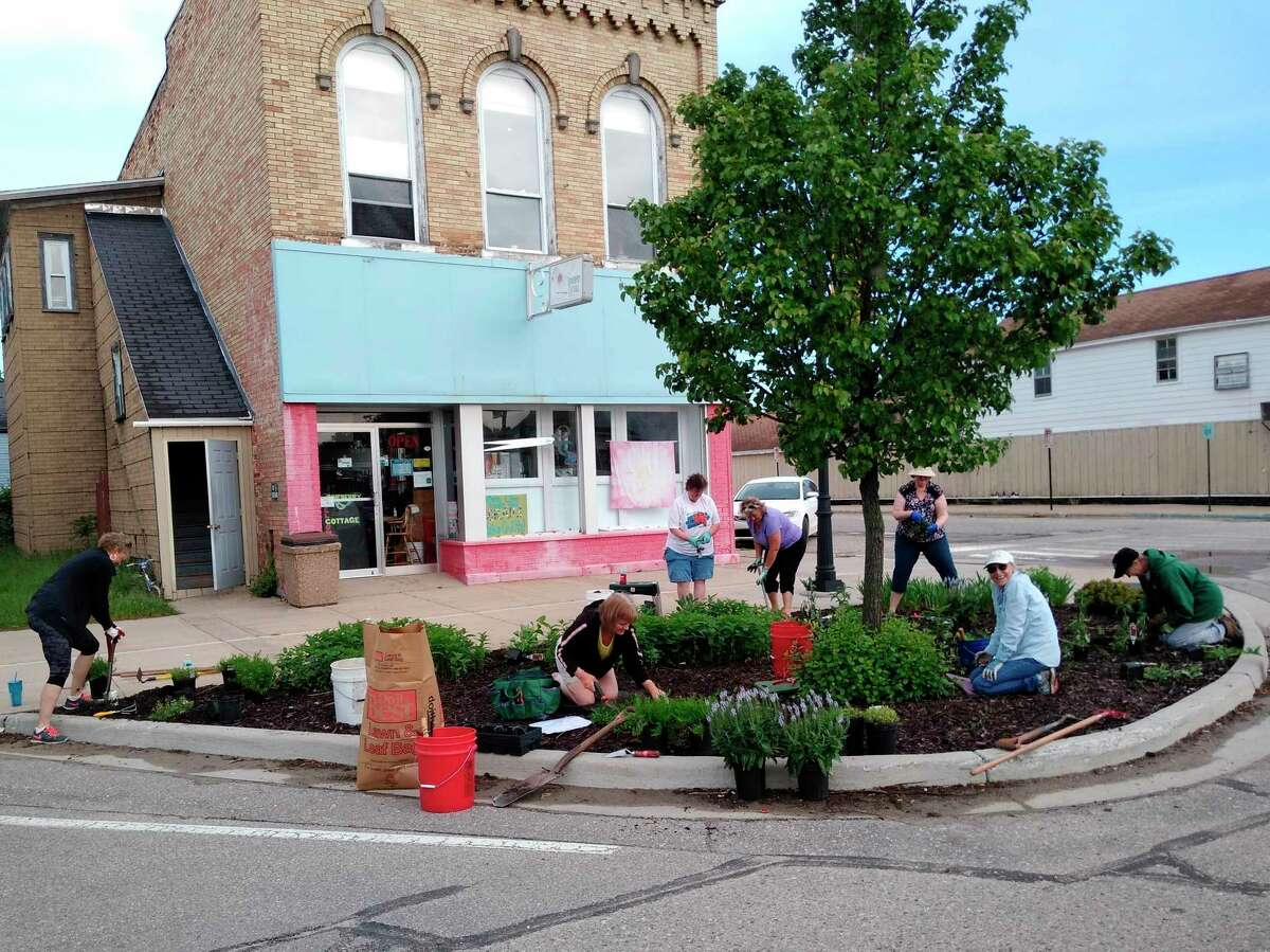 The Evart Garden Club was hard at work last spring refurbishing the flowerbeds around downtown Evart planting native species to create a Monarch Waystation. The work will continue this spring with additional plants and additional flowerbeds throughout the city. (Submitted photo)