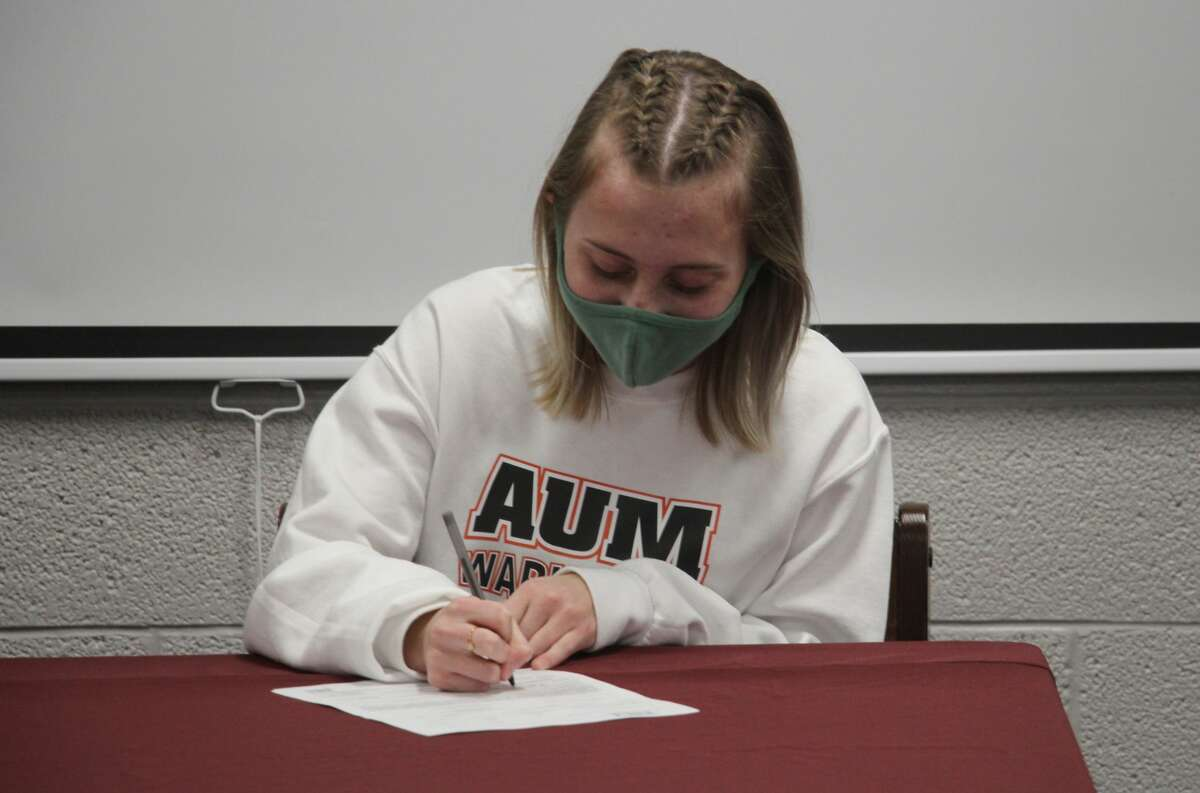 Cass City cross country runner Riley Copeland, surrounded by family and friends, signed a letter of intent on Tuesday to attend Auburn University at Montgomery.