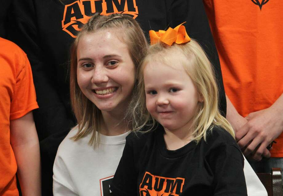 Cass City cross country runner Riley Copeland, surrounded by family and friends, signed a letter of intent on Tuesday to attend Auburn University at Montgomery. Photo: Mark Birdsall/Huron Daily Tribune