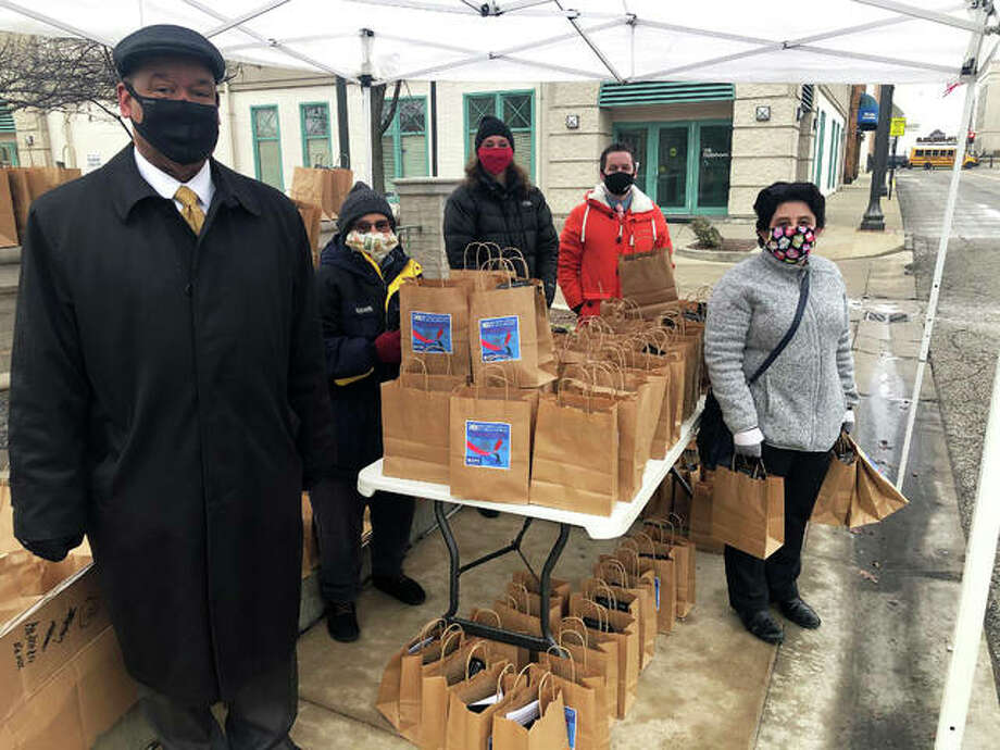 A group of city staff and volunteers spend time at city hall to hand out 2021 Business Forecast swag bags to attendees, to be enjoyed remotely while the event broadcast live on Tueday. Photo: Brittany Johnson | The Intelligencer