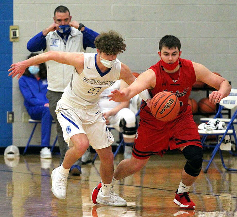 Jacob Suttles of North Greene (4) and a Pittsfield player chase a loose ball during Tuesday night's season-opening game in White Hall. Photo: Dennis Mathes, Journal Courier | For The Telegraph