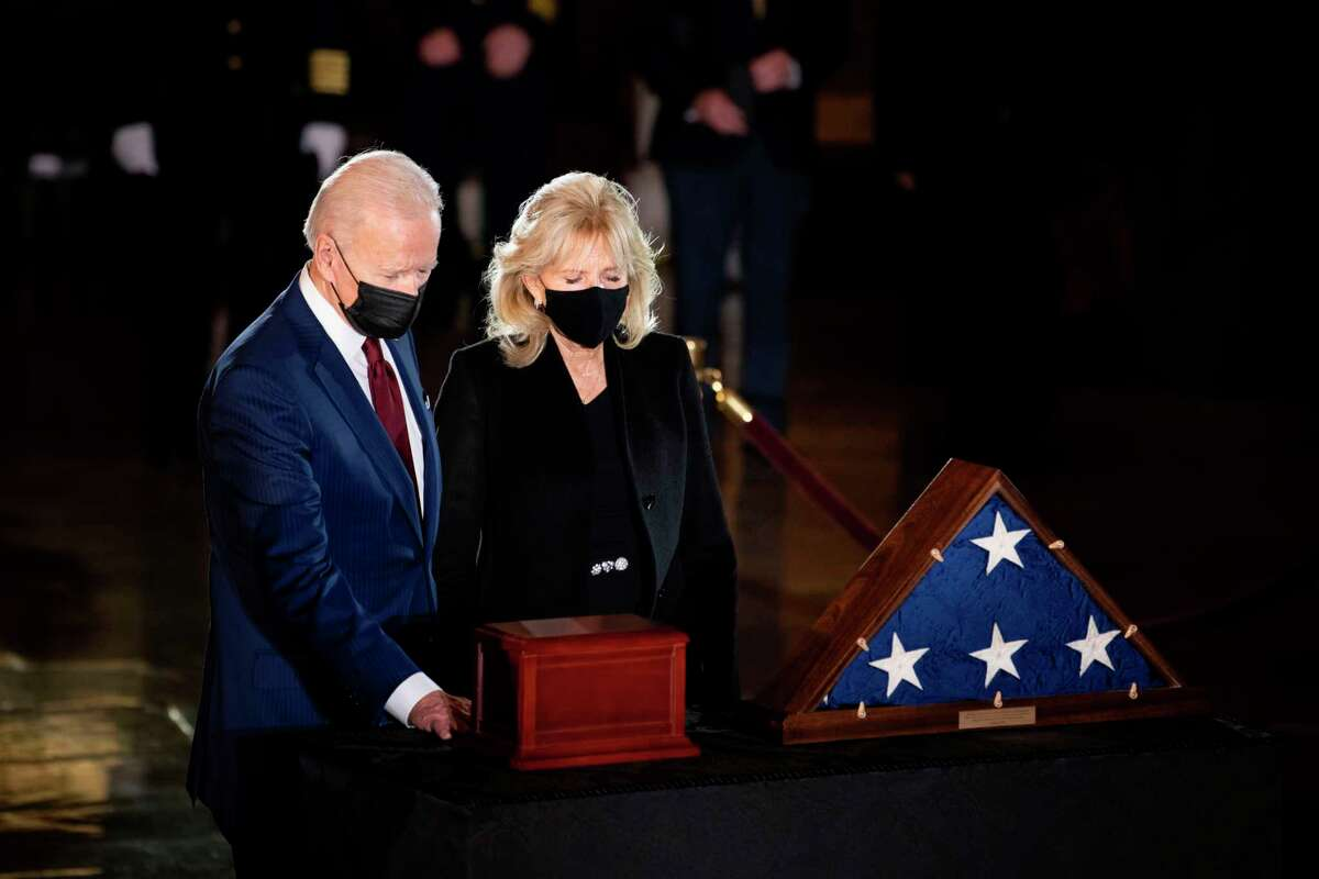 US President Joe Biden and First Lady Jill Biden pay their respects to late US Capitol Police officer Brian Sicknick, as he lies in honor in the Capitol Rotunda in Washington, DC February 2, 2021. Sicknick died on January 7 from injuries he sustained while protecting the US Capitol during the January 6 attack on the building (Photo by Brendan Smialowski / POOL / AFP)