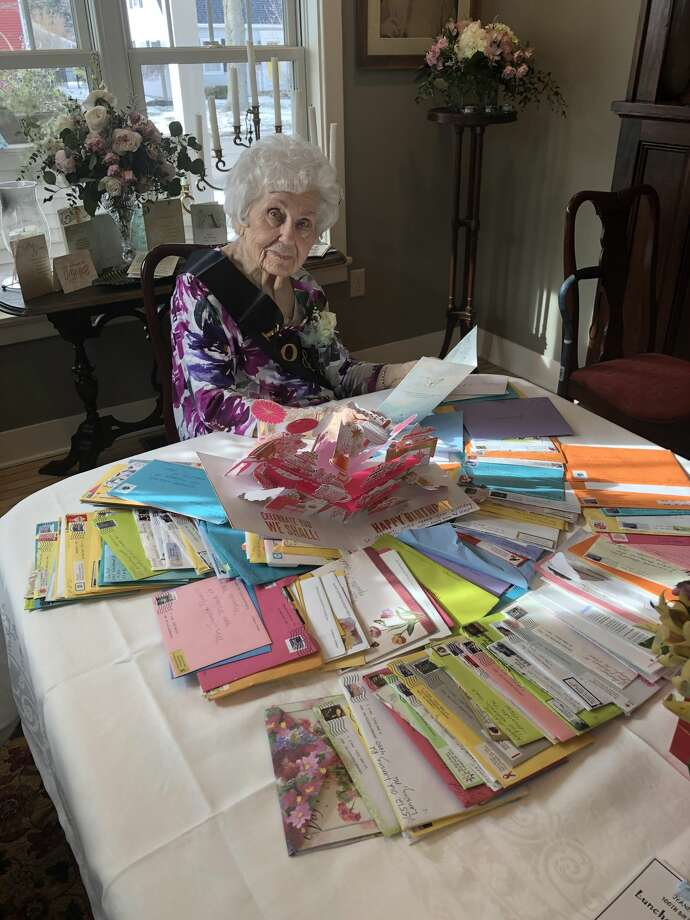 Jeanette Nuckolls looks over birthday cards and letters she received for her 100th birthday on Jan. 25. Photo: Courtesy Photo/Carol DuVall