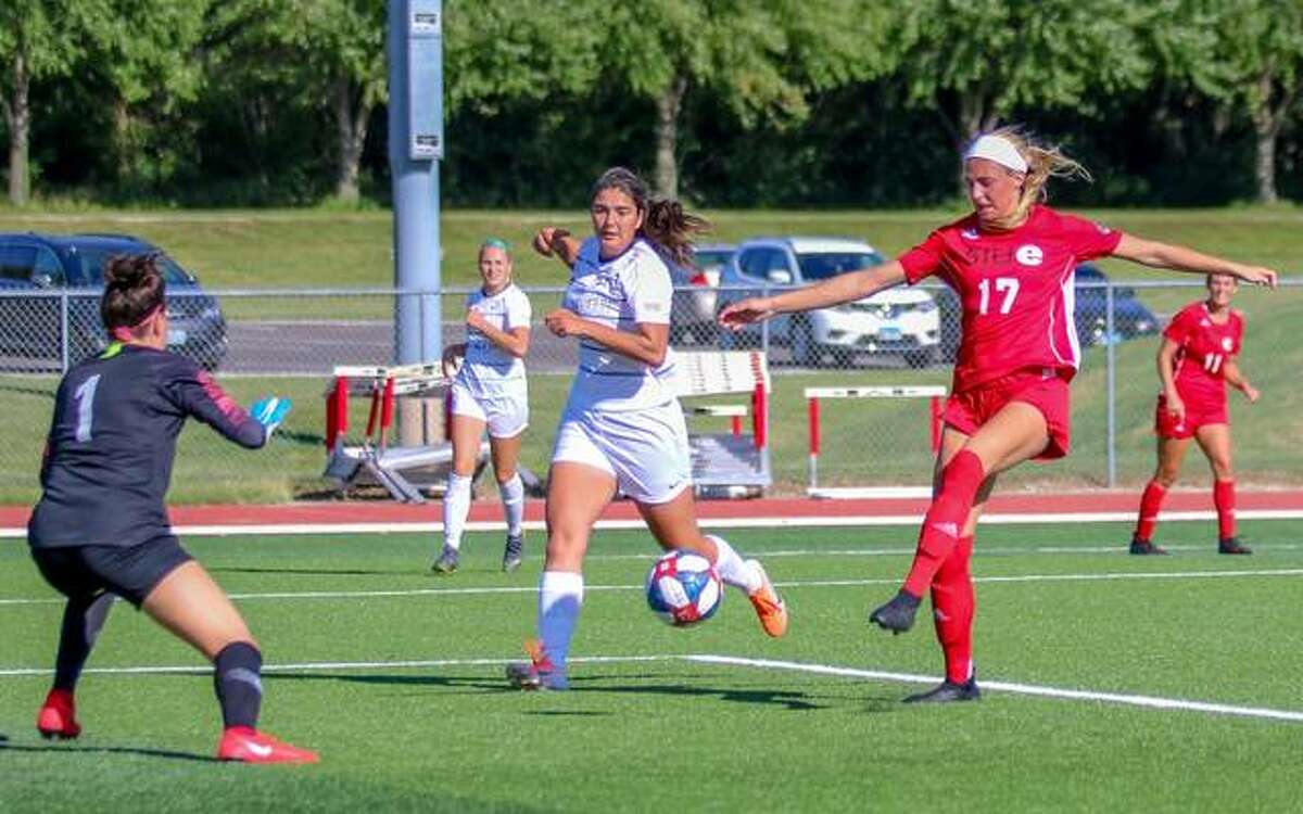 SIUE's MacKenzie Litzsinger, right, in action for the Cougars during a home game inside Ralph Korte Stadium.