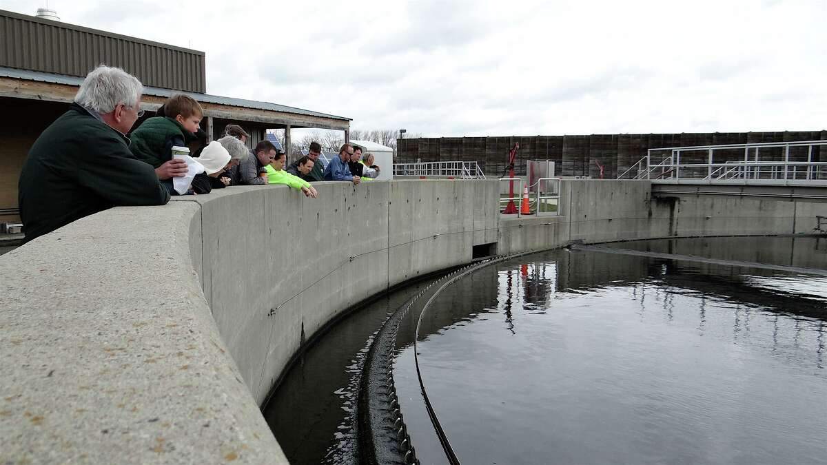 Visitors to Fairfield's water-pollution control plant peer Saturday into the final clarification station, the last stop for waste water being treated at the plant. FAIRFIELD CITIZEN, CT 4/20/13