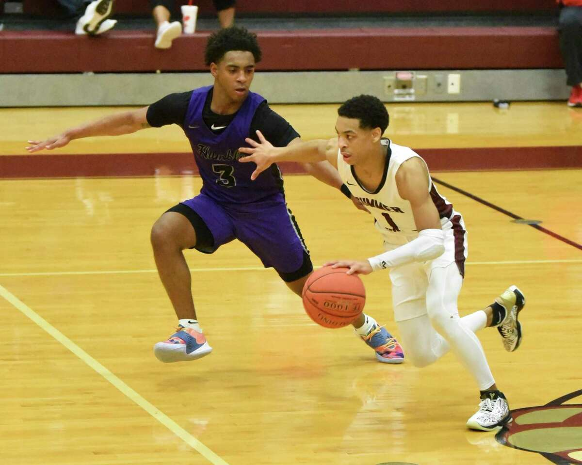 Summer Creek guard Jaleen Goodman dribbles the ball down the court in a District 21-6A game against Humble.
