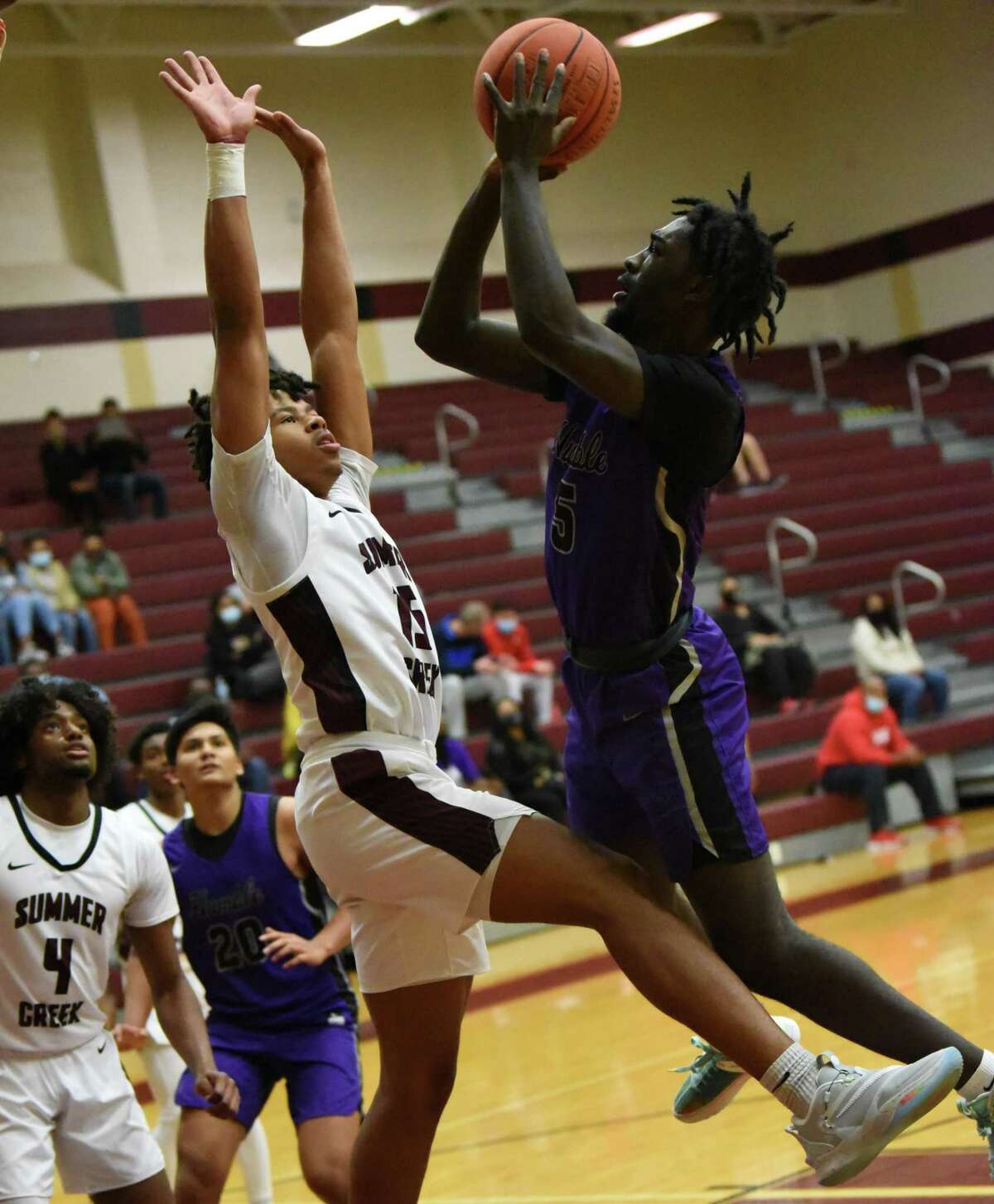 Humble guard Robert Williams goes up for a contested shot against Summer Creek's Reyce Allen.