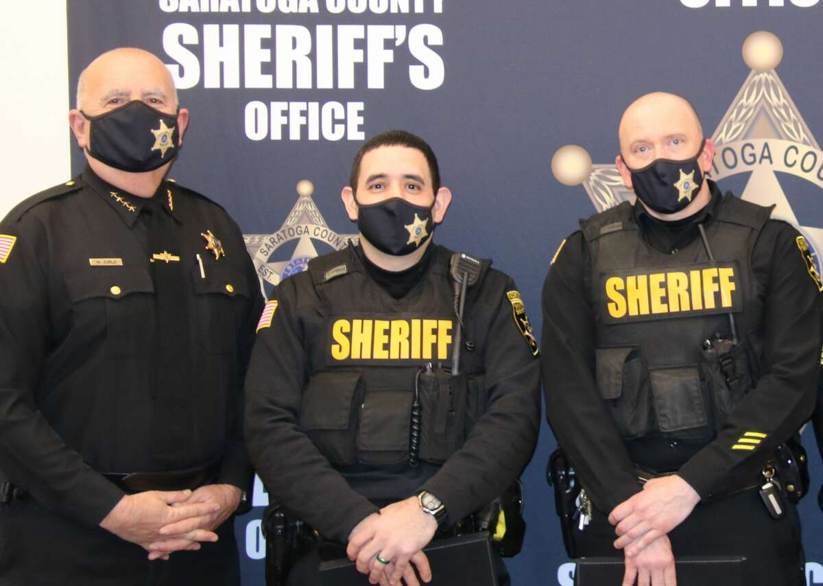 Saratoga County Sheriff Michael Zurlo, left, stands with deputies Eddie Hernandez and Jeffrey Kaplan who were recognized on Wednesday for saving the lives of a couple from Halfmoon on Jan. 28.