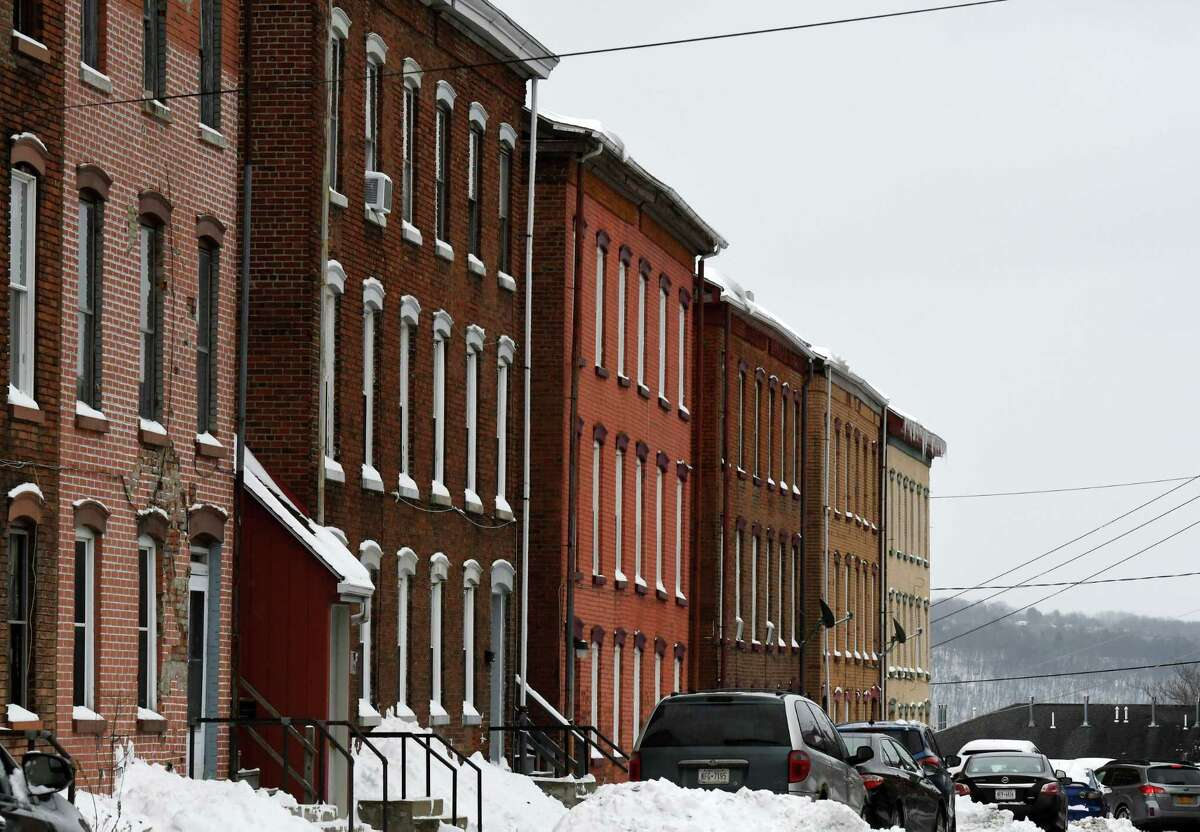 """Cataract Street former worker housing near Harmony Mills on Wednesday, Feb. 3, 2021, in Cohoes, N.Y. The row houses are possible set locations for """"The Gilded Age."""" (Will Waldron/Times Union)"""