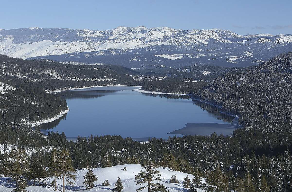Donner Lake is rimmed by new snow in the Sierra Nevada on Saturday in Truckee. Despite last week's storm, the state's snowpack remains below average.