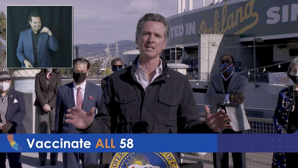 Gov. Gavin Newsom announces a new coronavirus vaccination site Wednesday in partnership with the federal government at the Oakland Coliseum. With him are state and local elected officials.