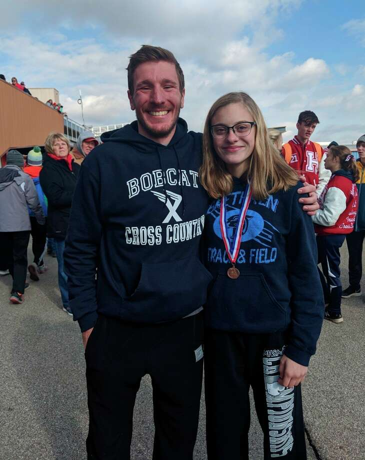 Brethren cross country coach Kyle Griffin and Alexis Tracy celebrate Tracy's first all-state finish to conclude her junior cross country season in 2019. (Submitted photo)