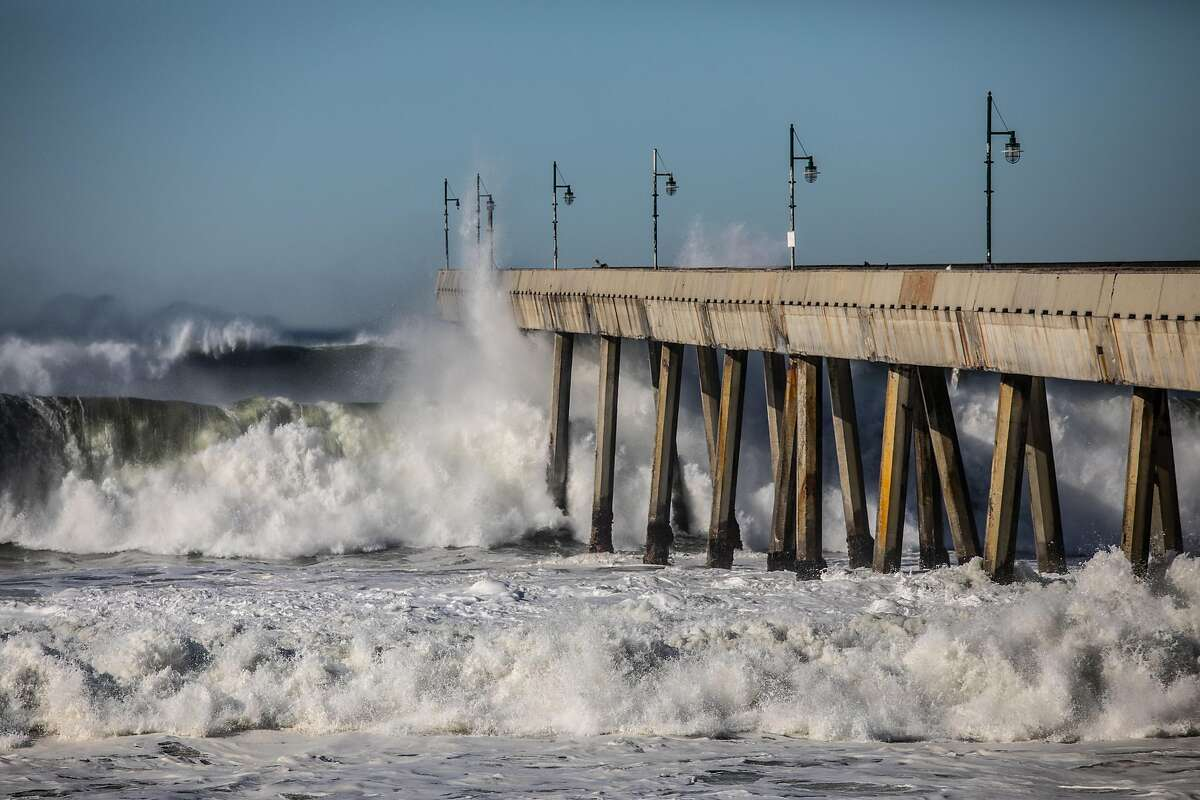 Waves crash against the Pacifica Pier in December.