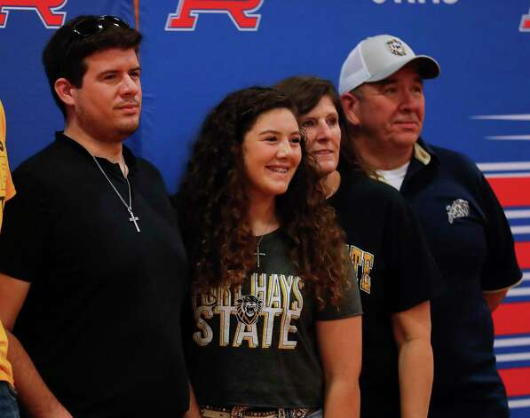 Erika Flynn, center, is seen after signing to play softball for Fort Hays State University during a National Signing Day ceremony at Oak Ridge High School, Wednesday, Feb. 3, 2020. Photo: Jason Fochtman, Staff Photographer / 2021 © Houston Chronicle