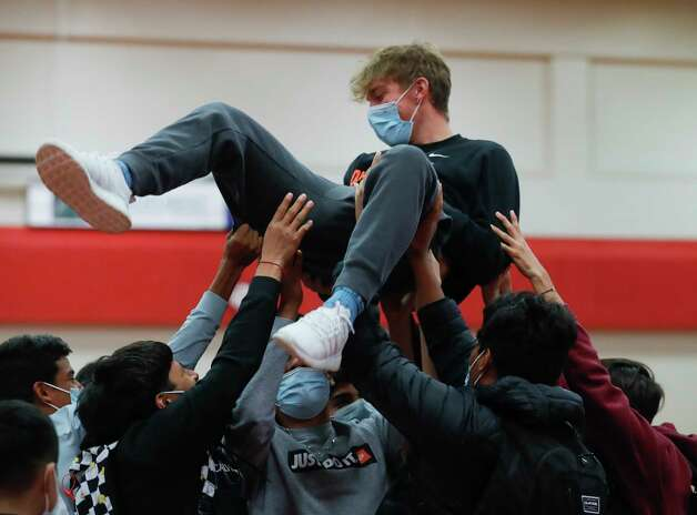 Lucas Hickey is lifted into the air by his teammates after signing to play soccer for Ohio Northern University during a National Signing Day ceremony at Oak Ridge High School, Wednesday, Feb. 3, 2020. Photo: Jason Fochtman, Staff Photographer / 2021 © Houston Chronicle