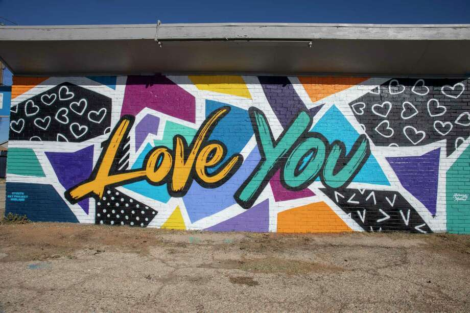 A new mural with ???Love You??? in writing done by Artworks Midland and the Youth Art Project as seen Wednesday, Feb. 3, 2021 at 2514 W. Ohio Ave.  Jacy Lewis/ Reporter-Telegram Photo: Jacy Lewis/ Reporter-Telegram