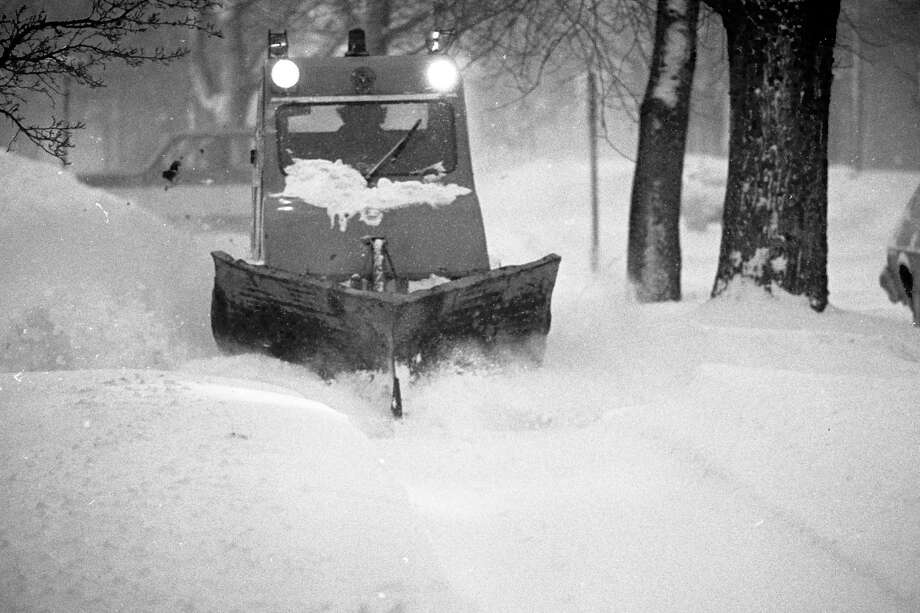 This photo was originally published on this day in 1981 in the News Advocate with the following cutline: This strange looking vehicle is beginning to look a little less strange every day to the countless residents of the city of Manistee who depend on their legs and the sidewalks for getting around. Two of these tracked vehicles have been constantly busy for weeks now plowing sidewalks throughout the city. (Manistee County Historical Museum photo)