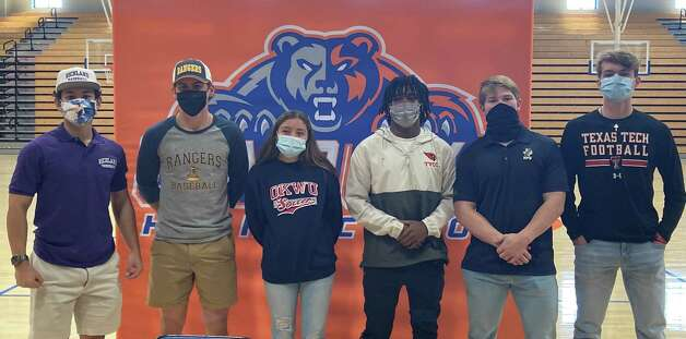 Six student-athletes signed to play at the college level at a National Signing Day ceremony at Grand Oaks High School on Feb. 3, 2021, in Spring, Texas. Photo: Justin Maskulinski, Staff Writer
