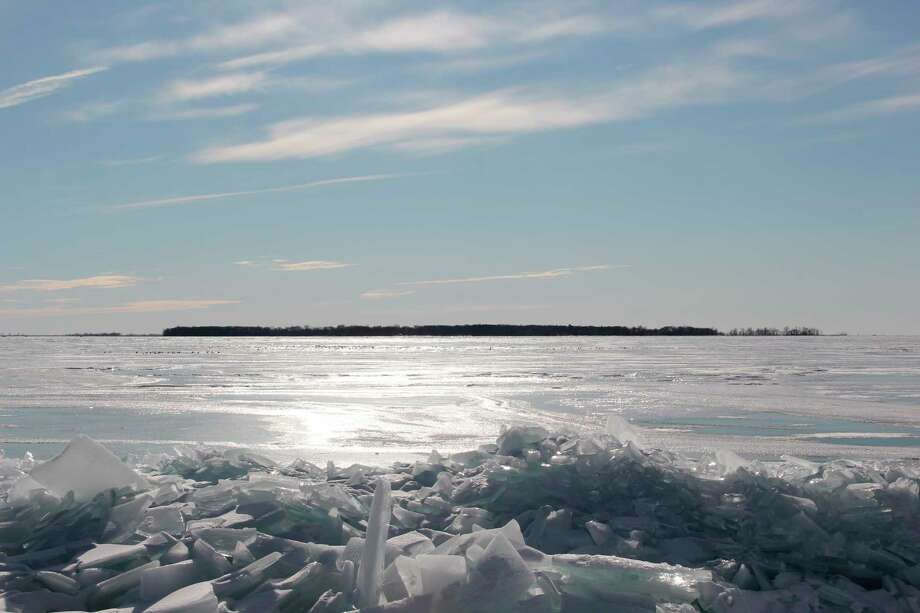 The shoreline facing Wild Fowl Bay is covered in ice stretching to the island in the bay. Despite this, ice cover in the Great Lakes is at one of its lowest known recorded points. (Robert Creenan/Huron Daily Tribune)