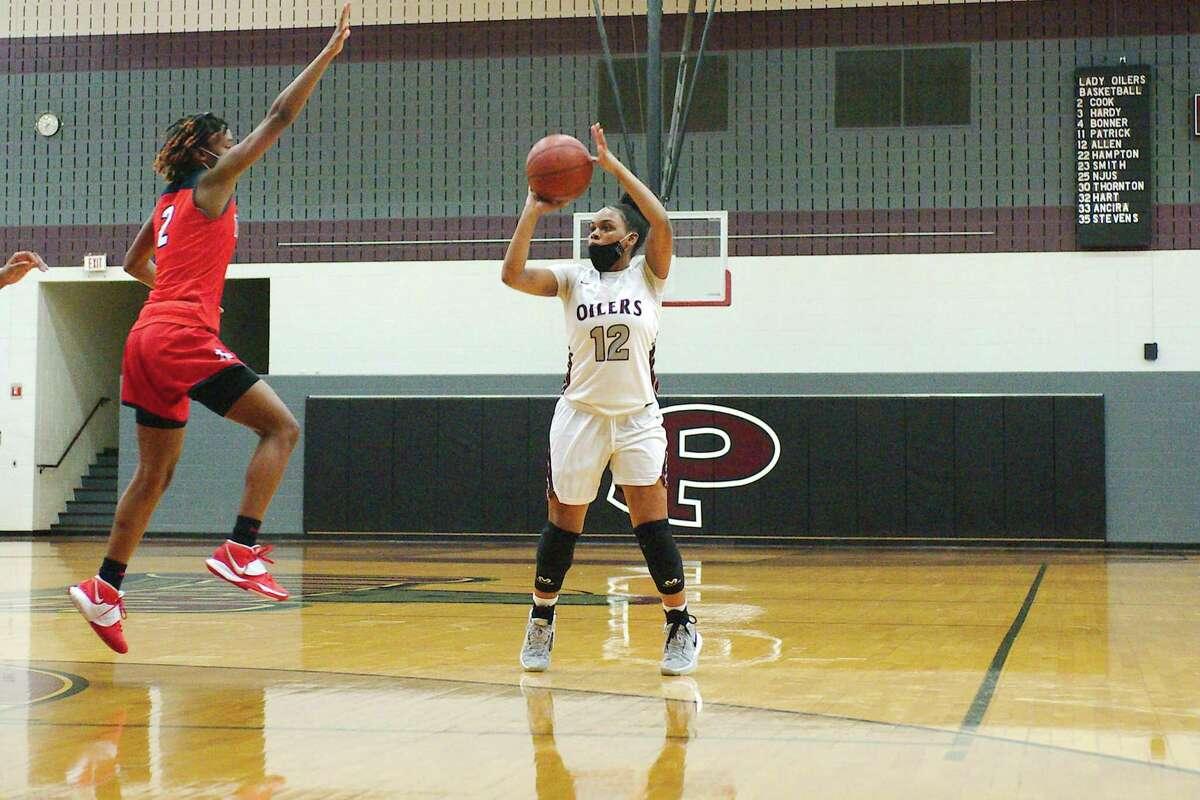 Pearland's Jasmin Allen (12) puts up a 3-pointer against Alief Taylor Tuesday at Pearland High School.