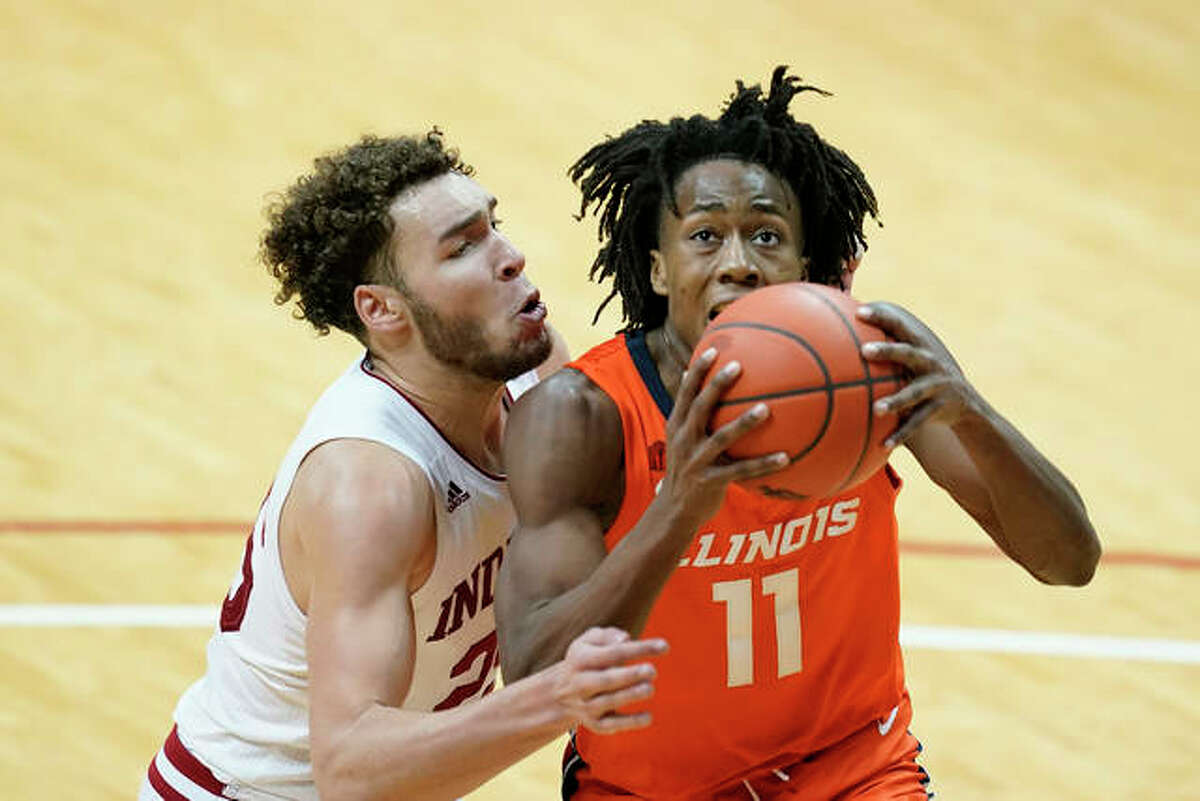 Illinois' Ayo Dosunmu (11) goes to the basket against Indiana's Race Thompson (25) during the first half of an NCAA college basketball game Tuesday, Feb. 2, 2021, in Bloomington, Ind.