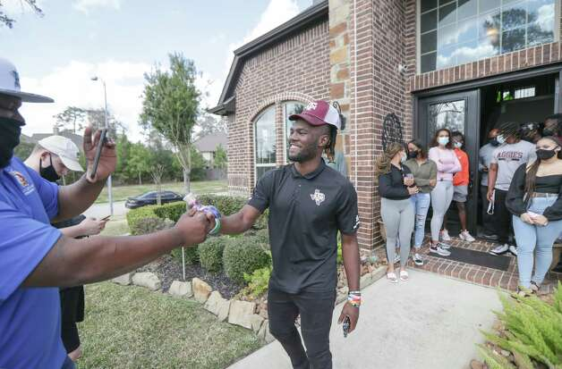 LJ Johnson, Cy-Fair running back was the center off attention after he announced his commitment to Texas A&M on National Signing Day Wednesday, Feb. 3, 2021, in Cypress. Photo: Steve Gonzales, Staff Photographer / © 2021 Houston Chronicle