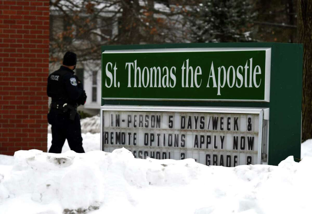 Bethlehem Police stand guard outside St. Thomas the Apostle School after it was put on precautionary lockdown after receiving a threat of violence on Wednesday, Feb. 3, 2021, in Delmar, N.Y. Police determined the threat was unfounded. (Will Waldron/Times Union)
