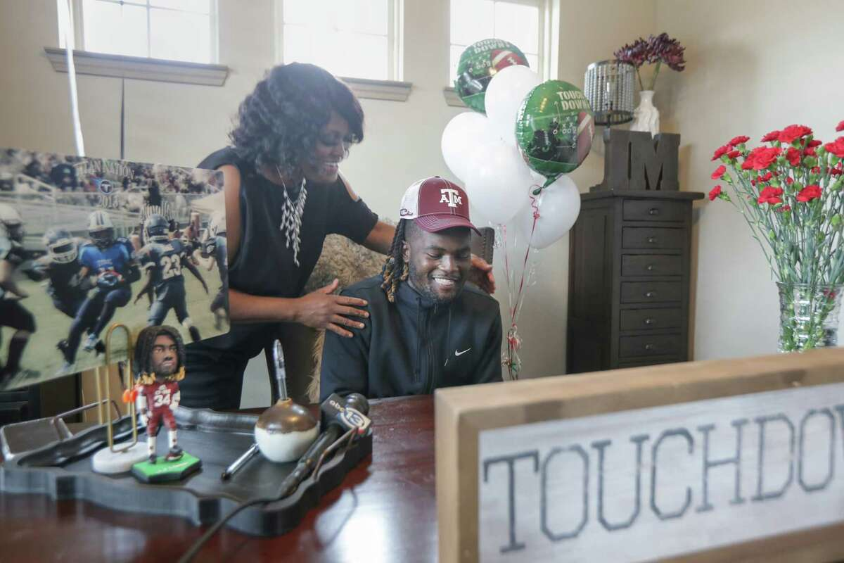 LJ Johnson, Cy-Fair running back announced his commitment to Texas A&M on National Signing Day to the delight of his mother, Alessia Johnson Wednesday, Feb. 3, 2021, in Cypress.