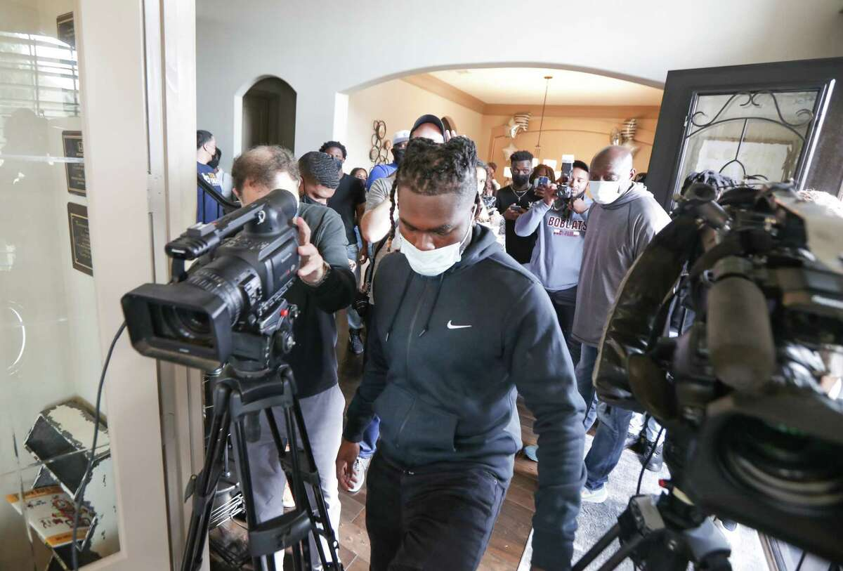 LJ Johnson, Cy-Fair running back, makes his way through a sea of family, friends and members of the press to announce his commitment to Texas A&M on National Signing Day Wednesday, Feb. 3, 2021, in Cypress.