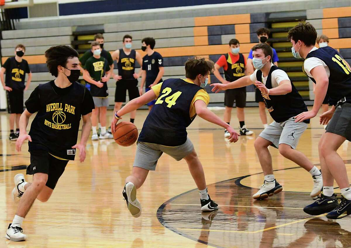 The Averill Park boys' basketball team practices on Wednesday, Feb. 3, 2021 in Averill Park, N.Y. Averill Park is testing student-athletes weekly to prevent the spread of COVID-19. (Lori Van Buren/Times Union)