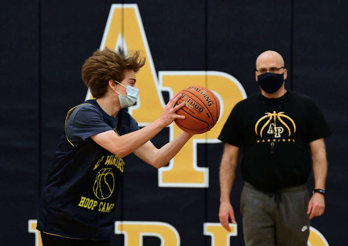 Coach Dave Pugliese watches his players as the Averill Park boys' basketball team practices on Wednesday, Feb. 3, 2021 in Averill Park, N.Y. (Lori Van Buren/Times Union)