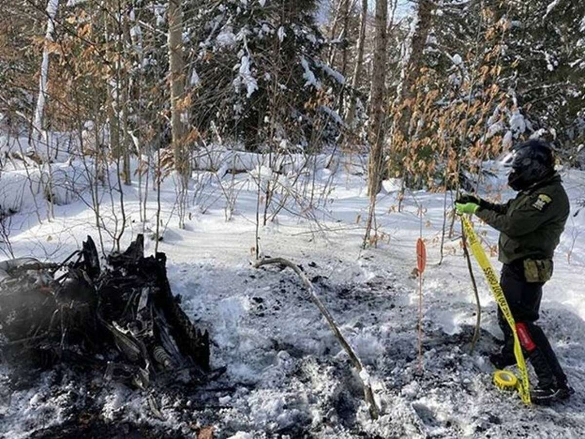 ECO Hilliard marks the burnt snowmobile to alert other riders in the town of Caroga