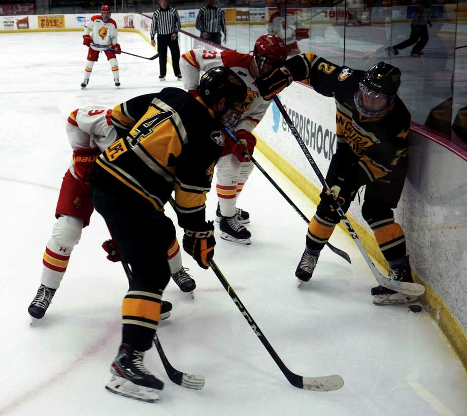 Ferris State and Michigan Tech hockey players battle for puck possession during Tuesday night's game at Ewigleben Ice Arena. (Pioneer photo/Joe Judd)