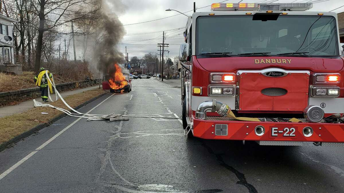 Police and Fire Department first responders put out a car fire on Balmforth Avenue in Danbury.