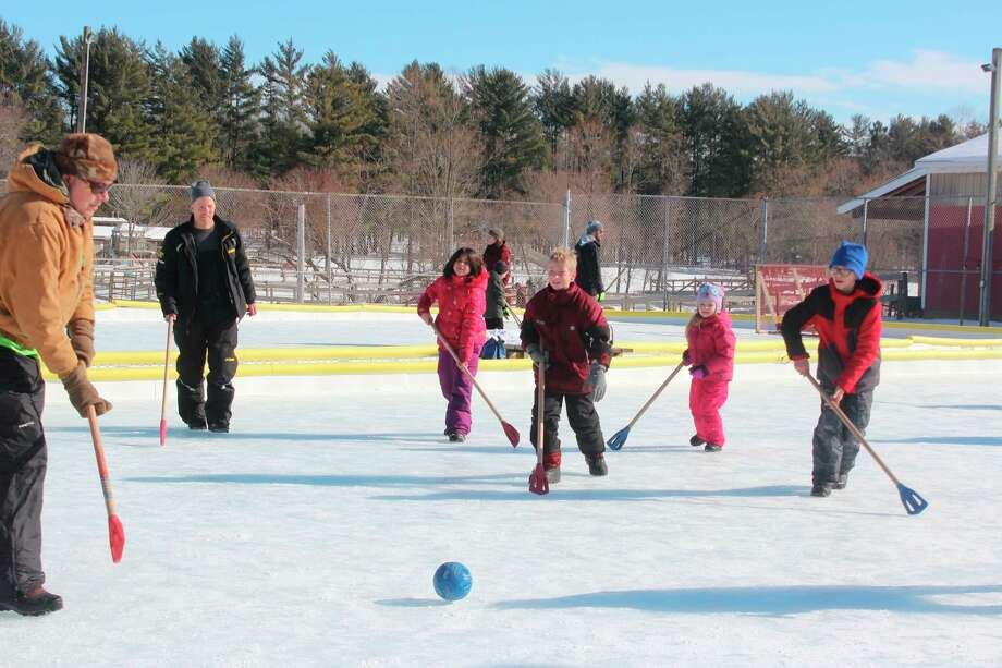 Area residents play broomball at CranHill Ranch, during the organization's 2020 Winterfest. With a multipurpose facility in the works, the campground will soon be able to offer more events and services for those in the community. (Pioneer file photo)