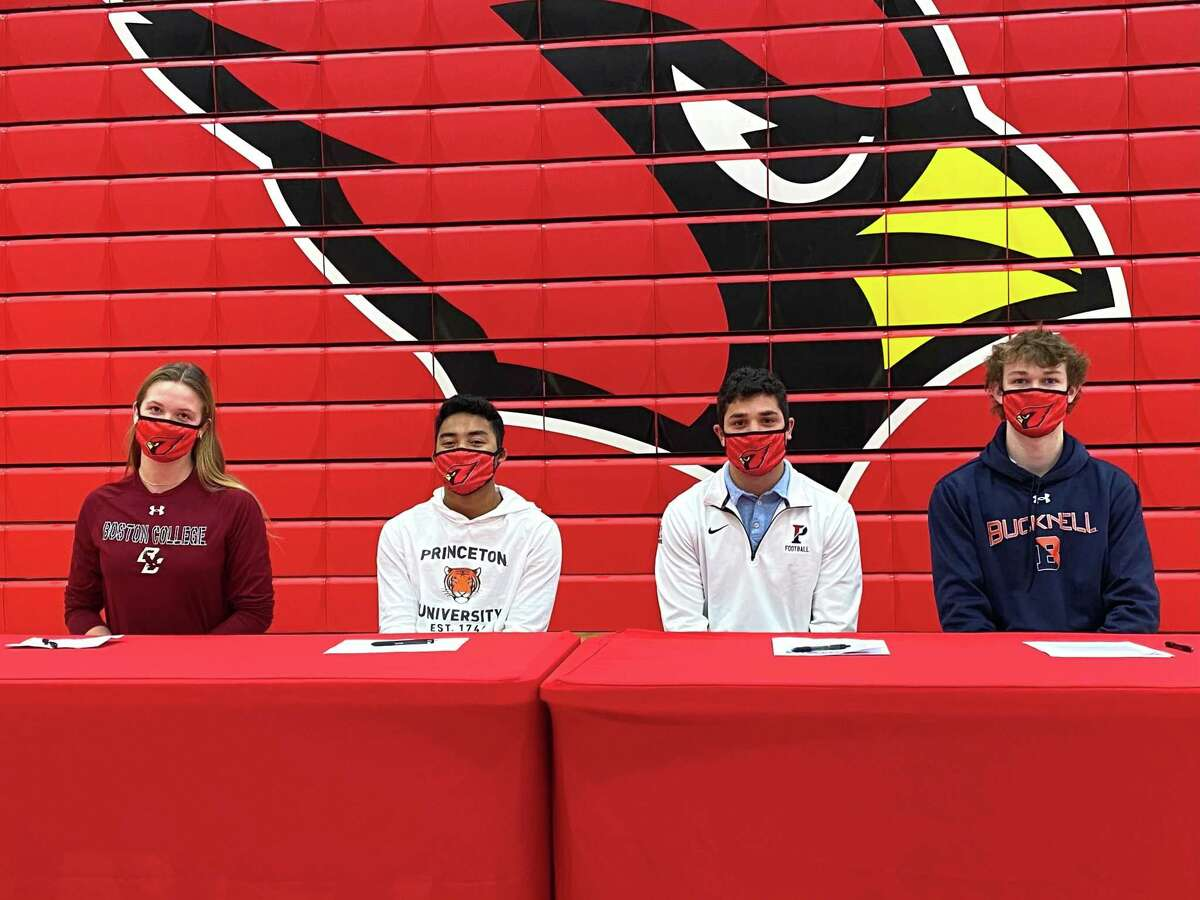 Cornelia Roach (Boston College), AJ Barber (Princeton), Kobe Comizio (UPenn) and Mason Muir ( Bucknell) sign National Letters of Intent and commitment letters to play sports in college at Greenwich High School on Wednesday.