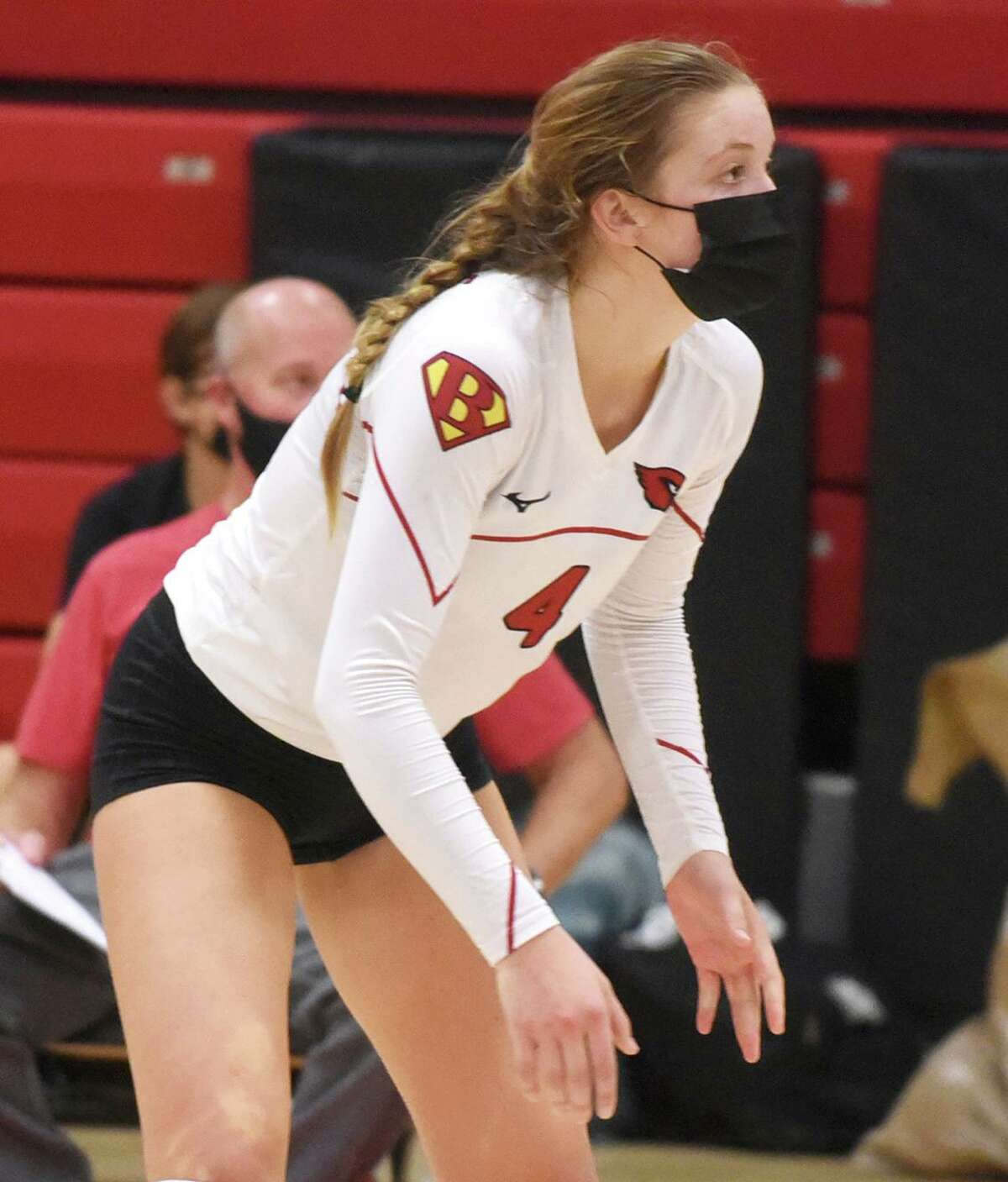 Greenwich's Cornelia Roach (4) awaits a serve during a girls volleyball contest at New Canaan High School on Thursday, Oct. 22, 2020.