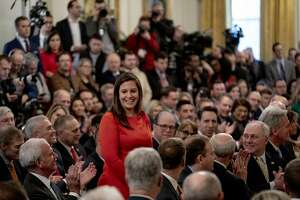 Rep. Elise Stefanik (R-N.Y.) stands as President Donald Trump recognizes her for her work during the impeachment hearings at the White House in Washington, Feb. 6, 2020.(Anna Moneymaker/The New York Times)
