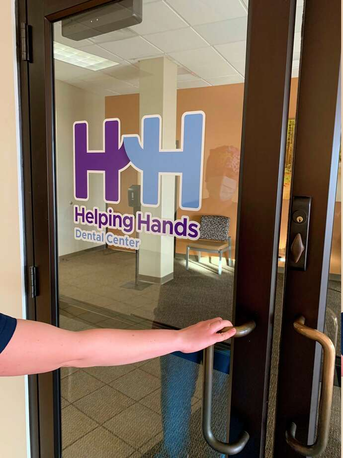 Three of the Midland area family foundations assist with major grant awards in keeping the doors open for patients at Helping Hands Dental Center. (Photo provided/Helping Hands Dental Center)