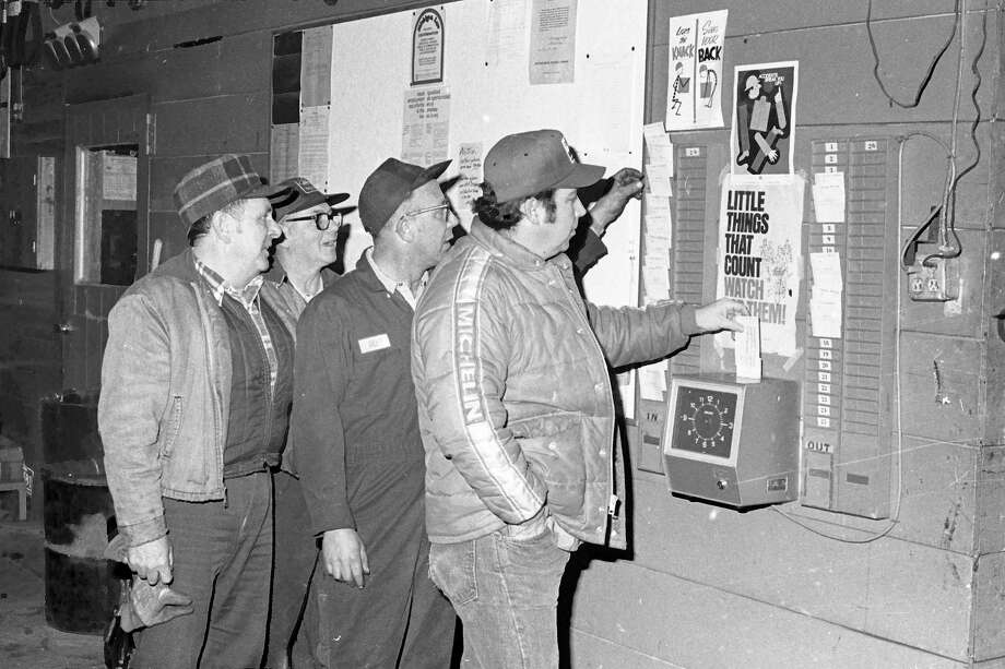 Employees of the Manistee Road Commission punch in for work this morning after reaching an agreement on their contract negotiations yesterday afternoon. Punching the time clock for the first time in 13 days left to right are: Rich Tetsworth, James Maue, Bill Hillart and Pete Thompson. The photo was originally published in the Manistee News Advocate on this day in 1981. (Manistee County Historical Museum photo)