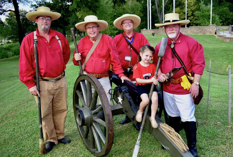 """Lone Star Volunteers and the """"Rolling Thunder"""" cannon. Todd Homman, Ron Brown, Ron McAnear, Mike Wilson and Mike Wilson's granddaughter Joanna Vail pose at the cannon, """"Rolling Thunder."""" The Lone Star Volunteers will participate in the state's official Texas Independence Celebration that will take place in Conroe Feb. 27. Photo: Photo By Pat Spackey"""