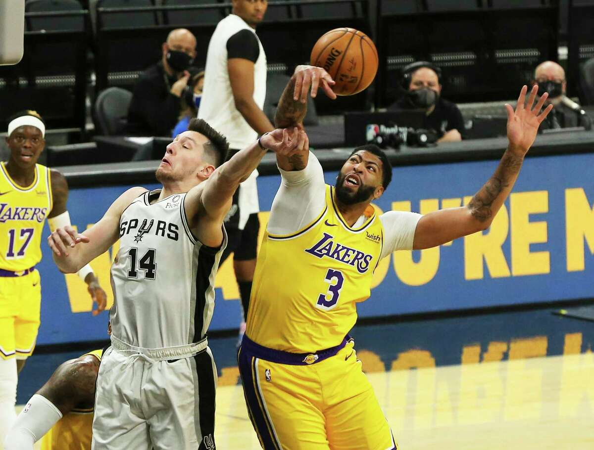 Spurs' Drew Eubanks (14) get his shot swatted away by Los Angeles Lakers' Anthony Davis (03) during their game at the AT&T Center on Wednesday, Dec. 30, 2020.