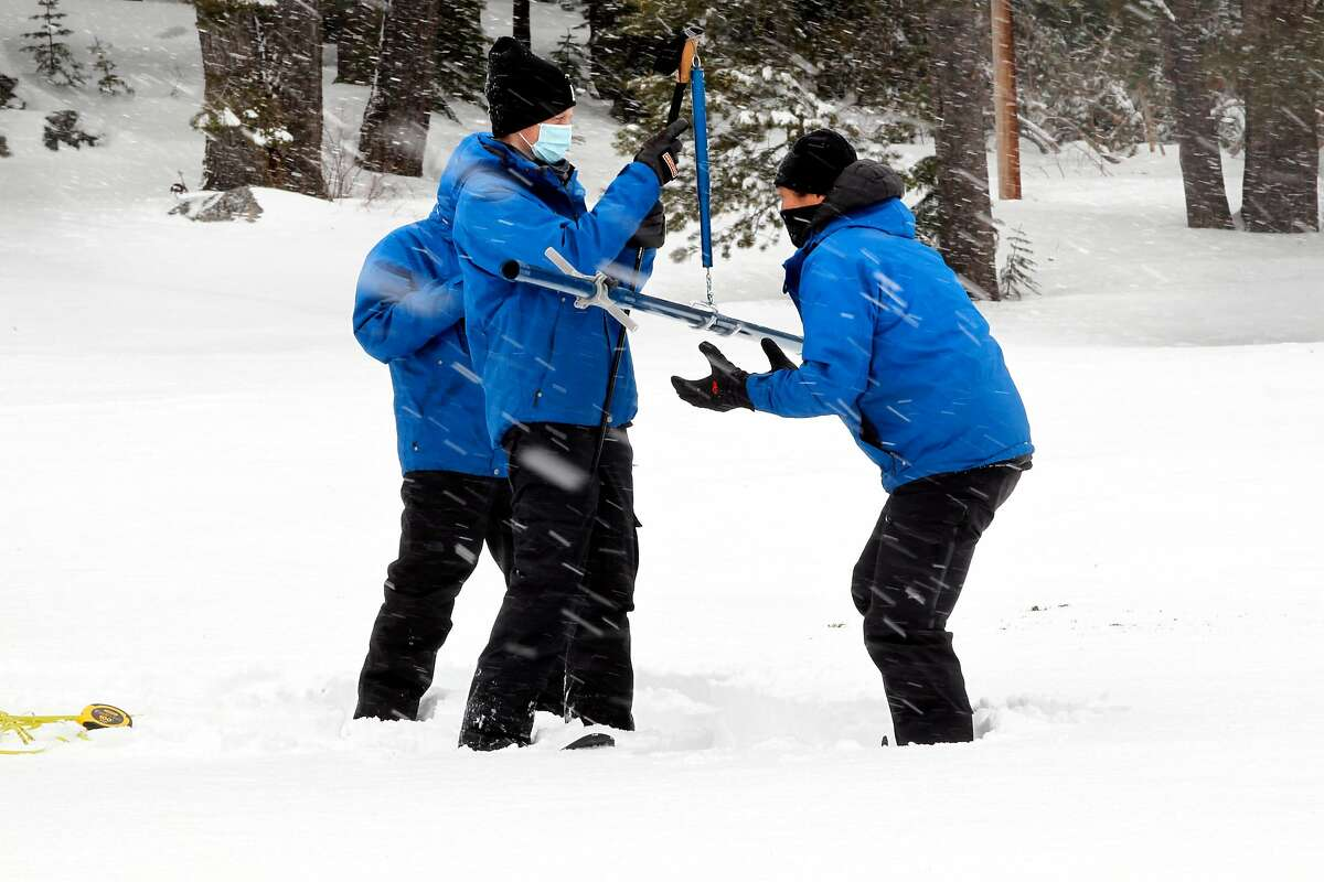 A Department of Water Resources team on Wednesday checks the weight of a snow sample at Phillips Station.