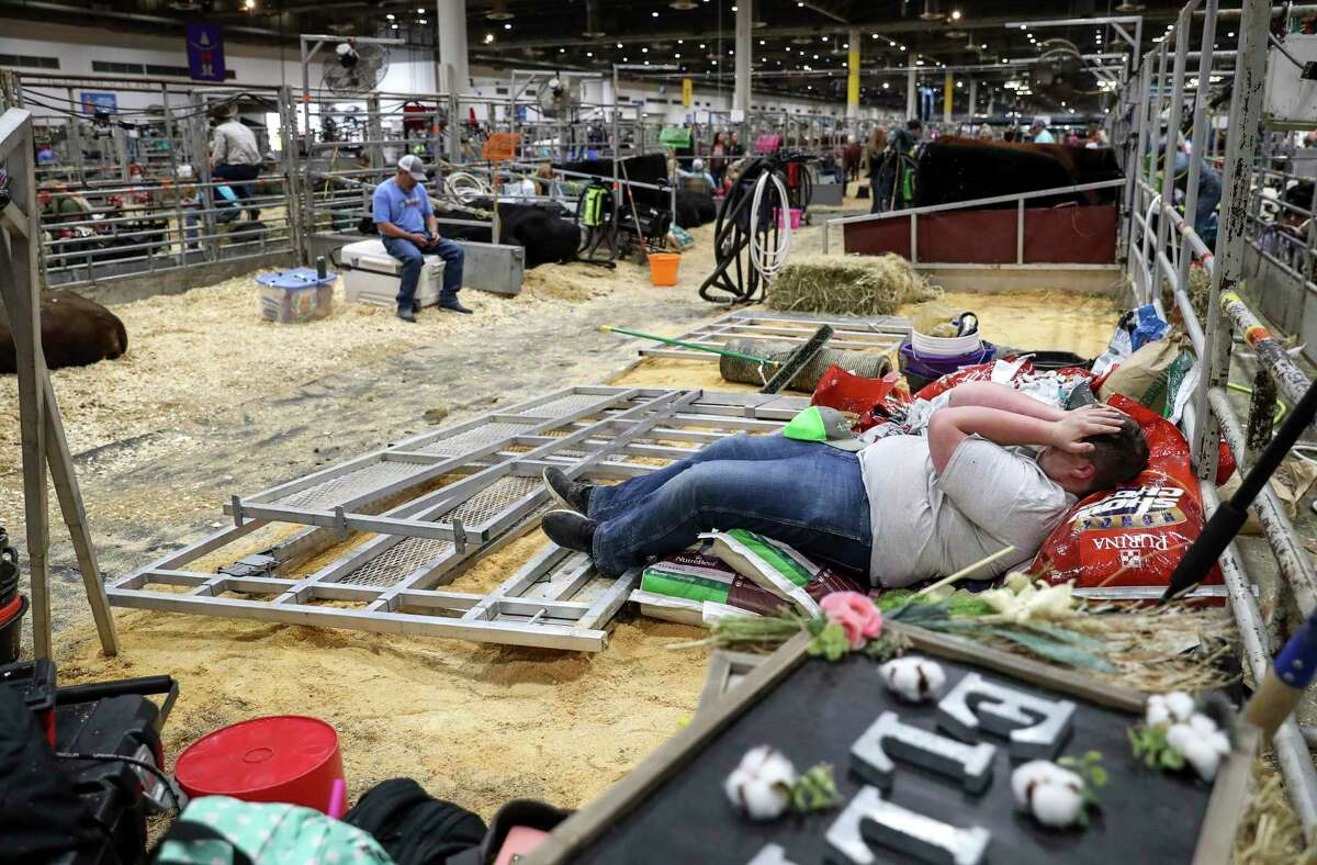 Nathan Feuquay, a senior from Lindale, Texas, rubs his face as he waits to load out after the Houston Livestock Show and Rodeo was canceled due to concerns about COVID-19, on Wednesday, March 11, 2020, at NRG Center in Houston.