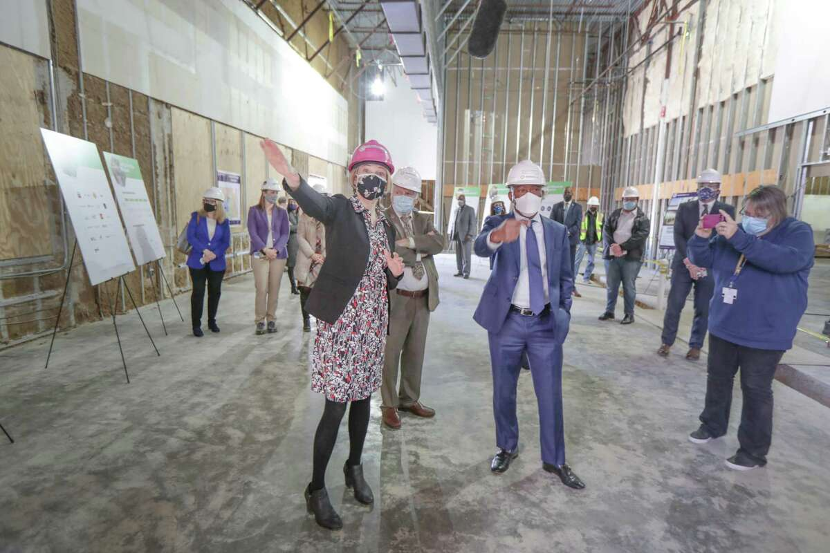 Greentown Labs CEO Emily Reichert (left) gives Houston Mayor Sylvester Turner a tour of the Greentown Labs Houston, the local branch of the Massachusetts-based clean-energy incubator, that will be in the renovated old Fiesta grocery store in Midtown Tuesday, Feb. 2, 2021, in Houston.